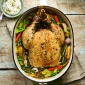Scandi-style chicken with braised spring veg and horseradish cream