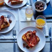 Banana and pecan French toast with bacon and vanilla syrup