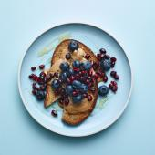 Nut butter on toast with blueberries and pomegranate