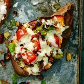Baked sweet potato with chorizo and melting cheese