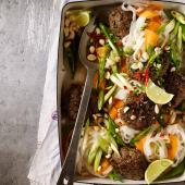 Massaman beef patties with noodles, lime and peanuts