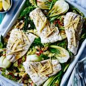 Sizzling haddock with greens and sesame seeds