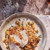 Roast chicken with orange, cumin and apricot rice