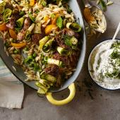 Lamb kebabs with pea, apricot and mint orzo and garlic yogurt