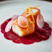 Smoked salmon with goats' cheese, lemon mousse and beetroot carpaccio
