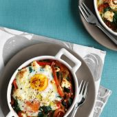 Baked eggs with spicy peppers, spinach and feta