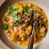 Chicken, pumpkin and chickpea korma with crispy shallots