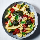 Pasta with roasted spinach polpette and tomatoes