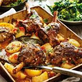 Greek lamb kleftiko with potatoes, oregano and lemon