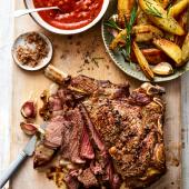 Salt and pepper rib of beef with Bloody Mary sauce and roast potato wedges