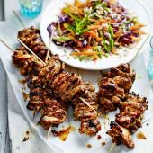 Spicy jerk chicken skewers with brown rice slaw