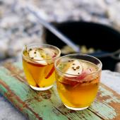 Hot toddy with bay leaves and orange