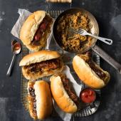 Sausages with beer-braised onions