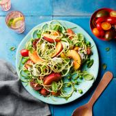 Summer garden salad with peaches and mozzarella