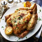 Roast chicken stuffed with lemony goats' cheese and tarragon
