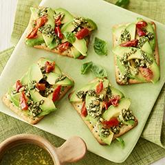 Chive crispbreads with avocado, semi-dried tomato and pesto topping