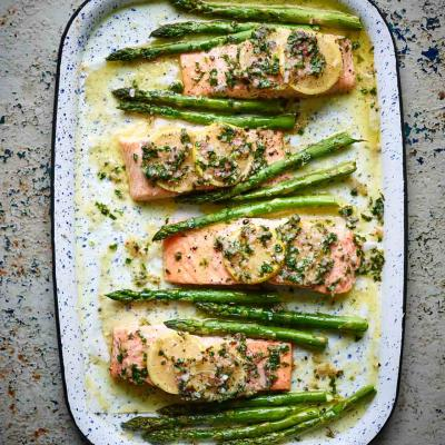 Salmon traybake with lemon butter and asparagus