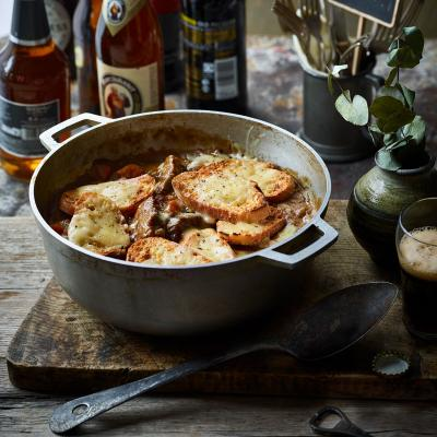 Beef and ale stew with cheese and mustard croûtes