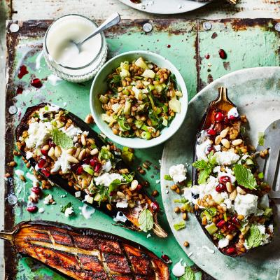 Baharat-spiced baked aubergines with feta, fennel and spelt