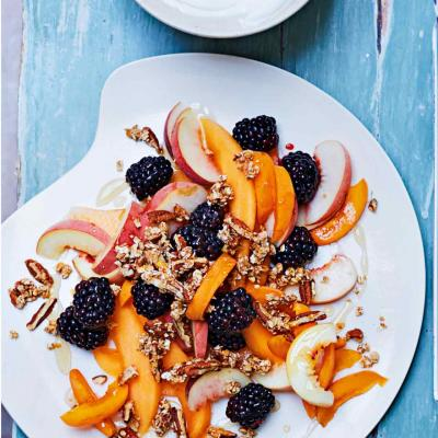 Breakfast fruit salad with pecan granola