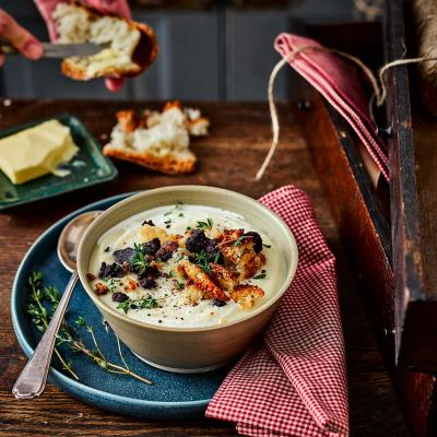 Maple-roasted celeriac and parsnip soup with black pudding crumbs