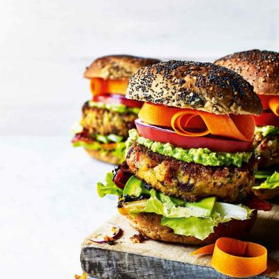 Stacked sweet potato burgers with avocado lime cream