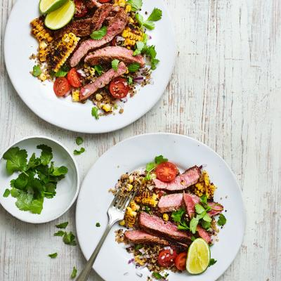 Steak with Cajun grilled corn salad