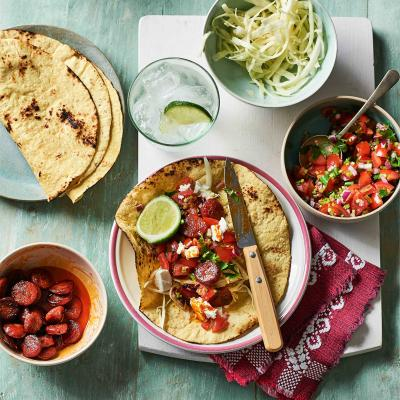 Chorizo tacos with salsa and feta