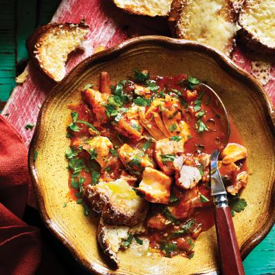 Mediterranean fish stew with cheese toasts