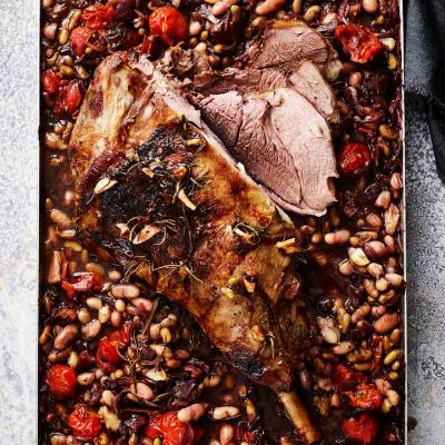 Slow-cooked leg of lamb with beans and tomatoes