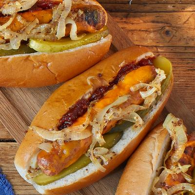 Melting cheese dogs with mustard onions