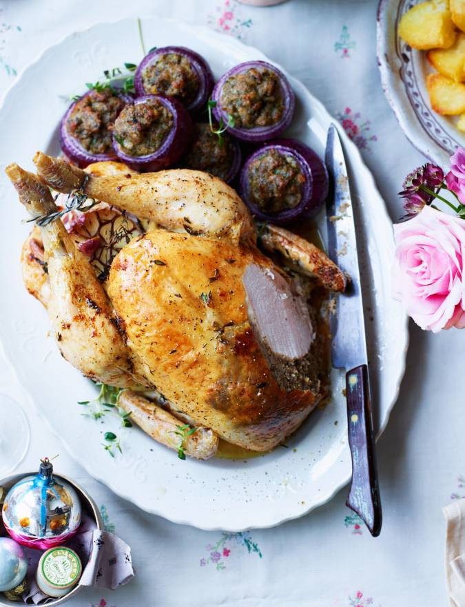 Recipe: Lemon, thyme and garlic-roasted chicken with chestnut stuffing-filled red onions