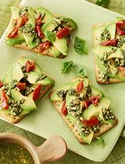 Recipe: Chive crispbreads with avocado, semi-dried tomato and pesto topping