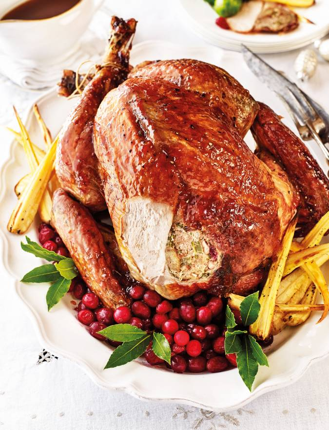 Recipe: Roast turkey with spiced cranberry-pecan stuffing and maple glaze