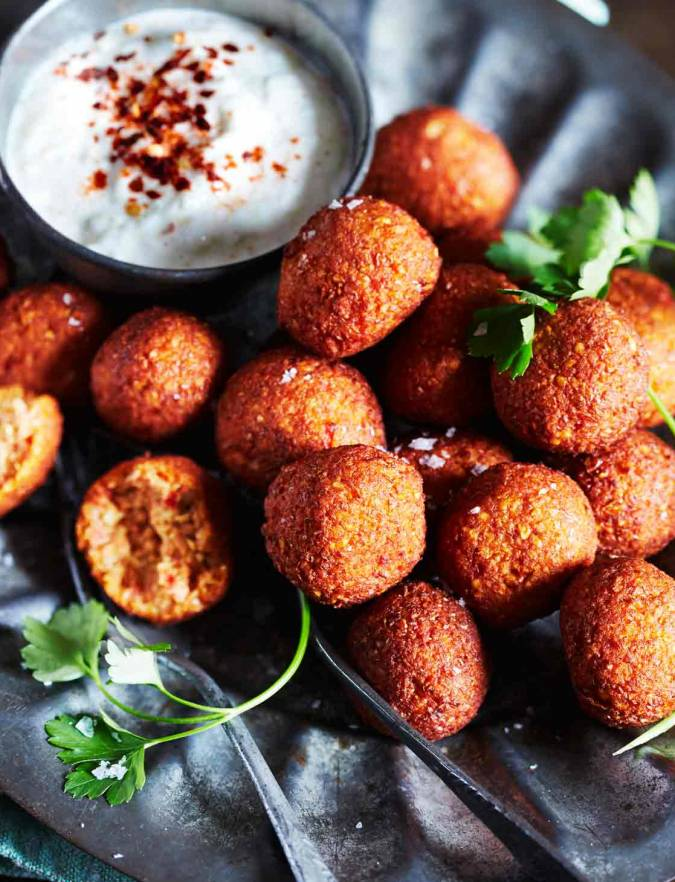 Recipe: Fragrant spiced red pepper falafel with smoky yogurt dip
