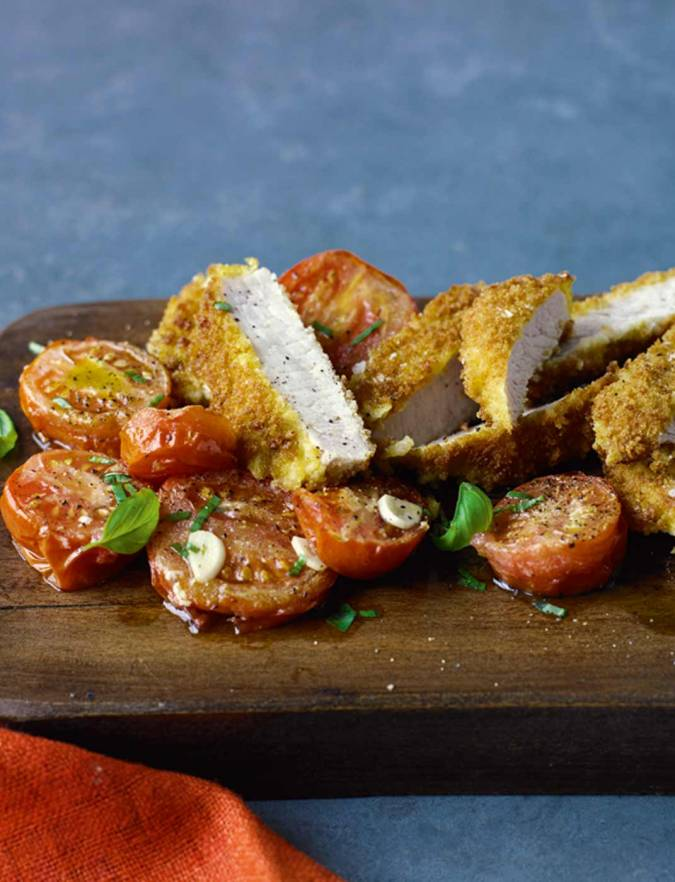Recipe: Parmesan-crumbed pork with roasted tomatoes