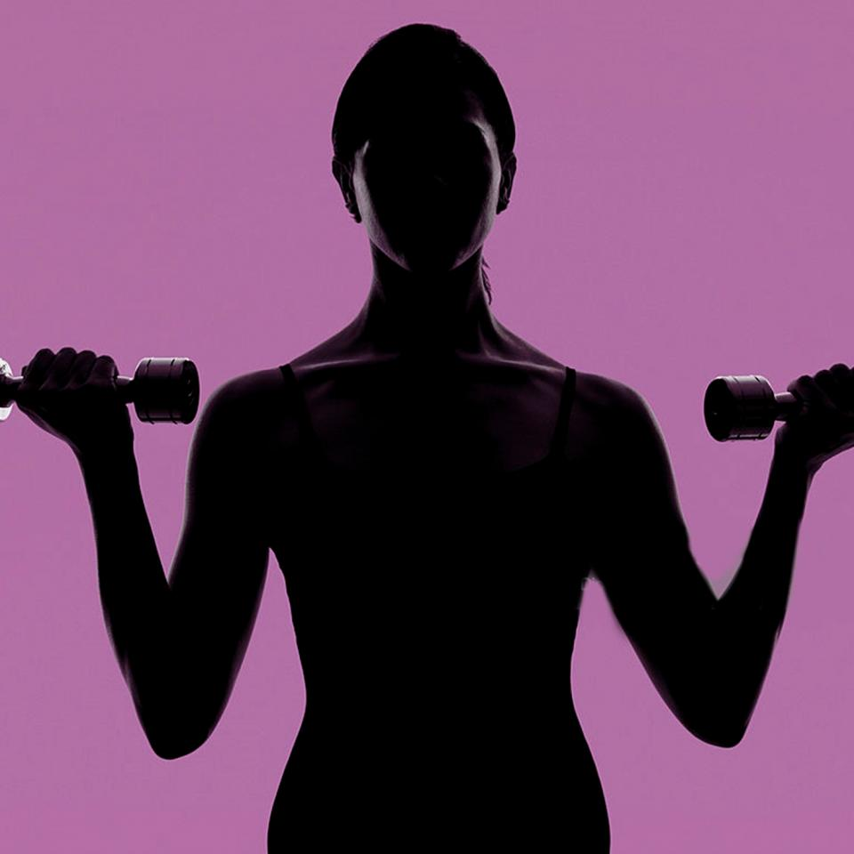 fitness-work-out-on-clean-purple-background-picture-id109864497