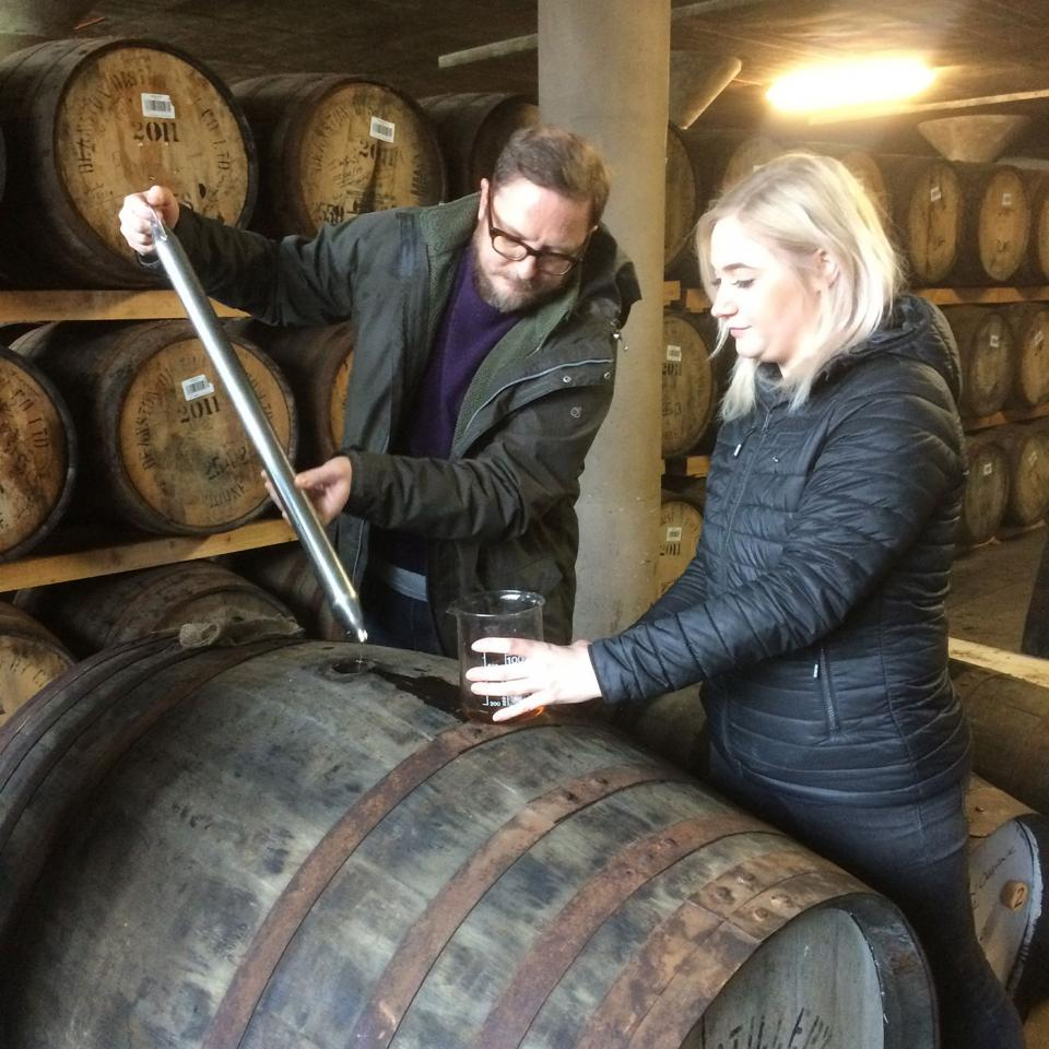 Me-siphoning-whisky-from-a-cask-at-Deanston-Distillery-2